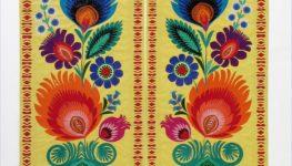 Zdjęcie kolorowe przedstawiające wycinankę z łowickim motywem kwiatowym