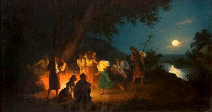 """Dzieło Henryka Siemiradzkiego pt. """"Noc świętojańska"""" przedstawiające grupę młodych osób przy ognisku, późnym wieczorem przy pełni księżyca."""