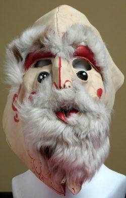 Maska skórzana peruwiańska przedstawiająca postać mężczyzny z obfitymi brwiami i brodą.